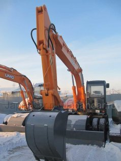 Экскаватор NEW HOLLAND E140W 2012 года в Хабаровске