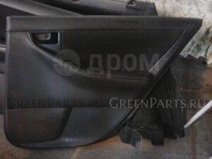 Обшивка двери на Toyota Corolla Fielder NZE121G