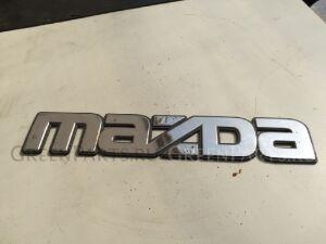 Эмблема на Mazda