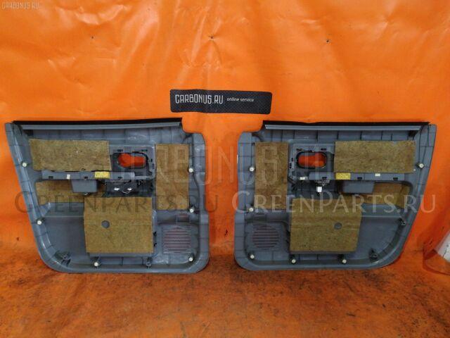 Обшивка двери на Nissan Cube BZ11