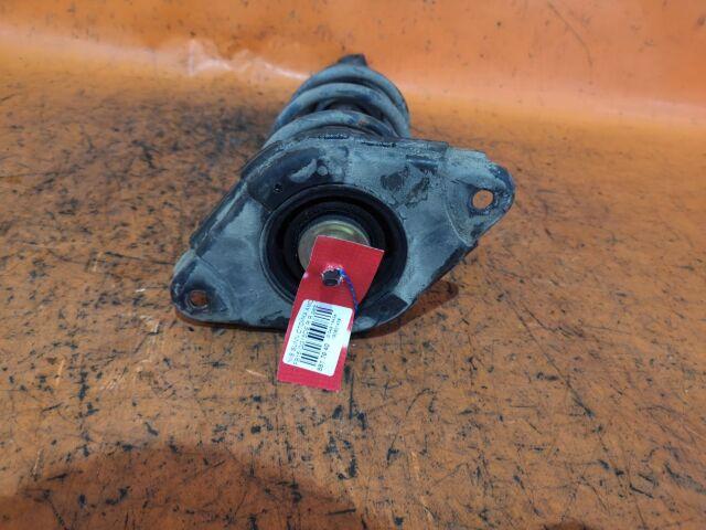 Стойка амортизатора на Nissan Almera N16