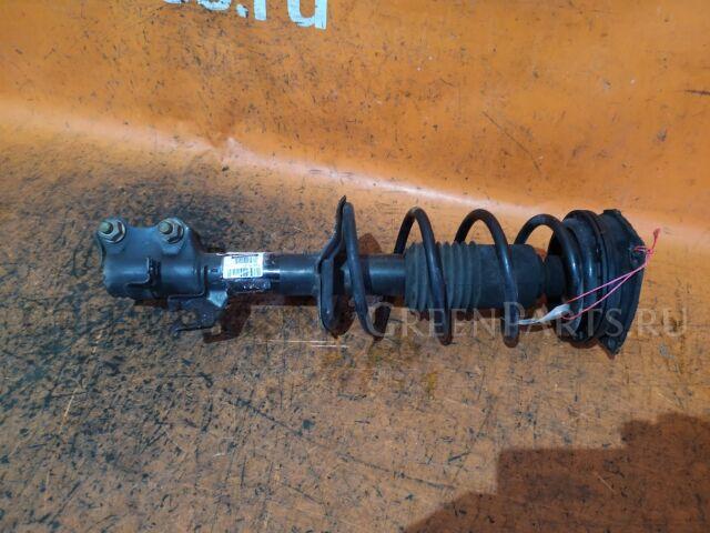 Стойка амортизатора на Nissan Tiida Latio SC11 HR15DE
