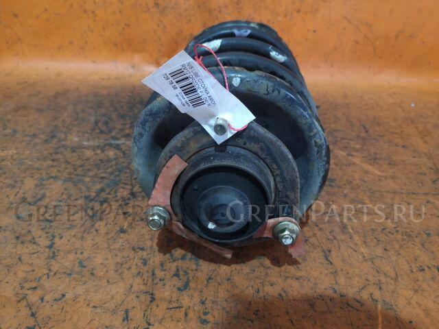 Стойка амортизатора на Nissan Liberty RM12 QR20DE