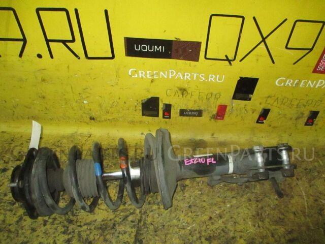 Стойка амортизатора на Toyota Raum EXZ10 5E-FE