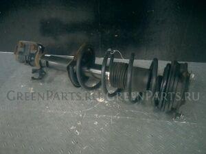Стойка амортизатора на Nissan March BNK12 CR14DE