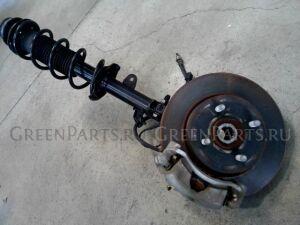 Стойка амортизатора на Nissan Note E12 HR12DE