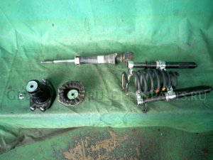 Стойка амортизатора на Toyota Corolla Fielder NZE144G 1NZ-FE