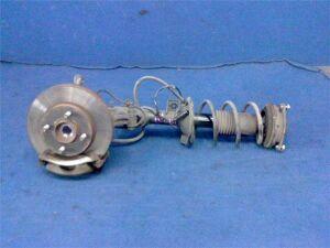 Стойка амортизатора на Nissan Tiida C11 HR15DE