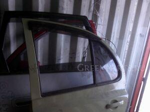 Обшивка двери на Nissan March AK12