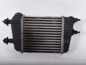 Радиатор интеркулера на Nissan Note E12 HR12DDR